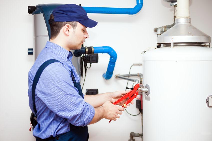 Plumber performing water heater replacement in manassas va