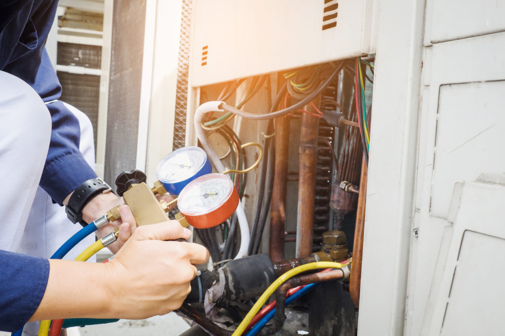 Tech is performing AC maintenance in centreville va