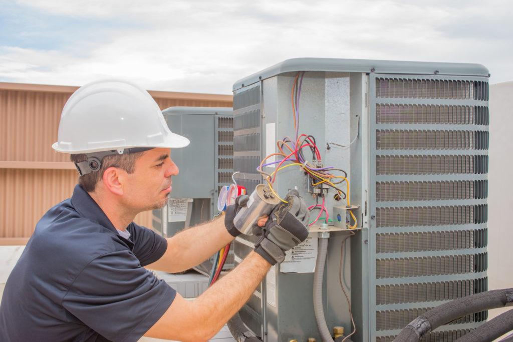 Tech Performing AC Repair in Gainesville